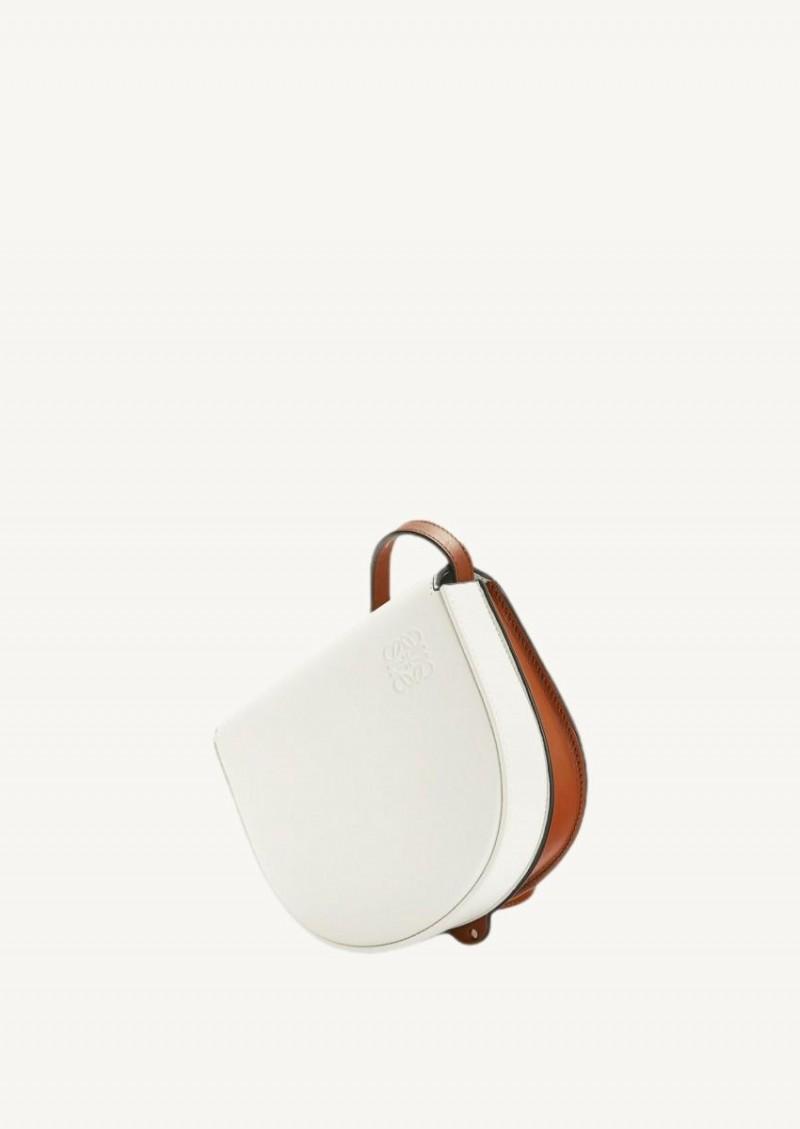 Soft white and dark tan Heel Duo bag in calfskin