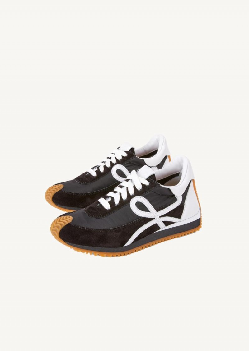 Black and white Flow Runner sneakers
