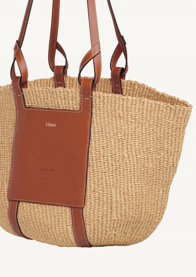Tan large basket in woven paper and smooth calfskin